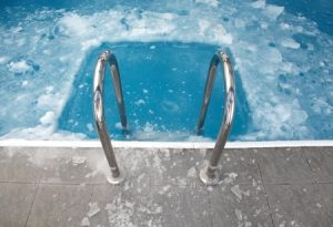 18289219 - steps in the frozen blue pool ice-hole